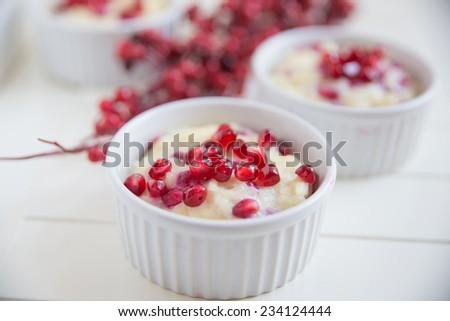 creamy rice pudding with pomegranate - stock photo