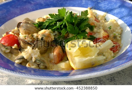 Creamy seafood risotto - stock photo