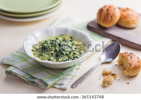 Creamy spinach dip with milk buns  - stock photo
