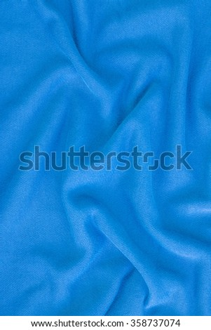 Creased blue cloth material fragment as a background - stock photo