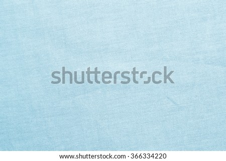 creased blue teal color harsh fabric textile texture background:detail of crumpled burlap backdrop:rustic seamless pattern canvas structure clothing concept:color of linen textile wallpaper picture - stock photo
