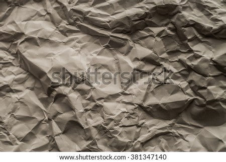 Creased brown paper surface texture as backgroud image - stock photo