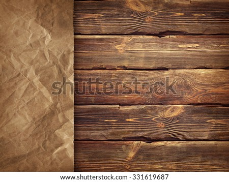 Creased handmade paper on wooden wall background