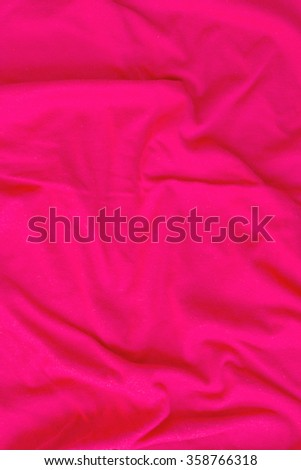 Creased pink cloth material fragment as a background - stock photo