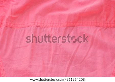 Creased pink cloth material fragment as a background