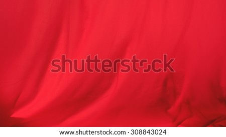 Creased red cloth material fragment as a background - stock photo
