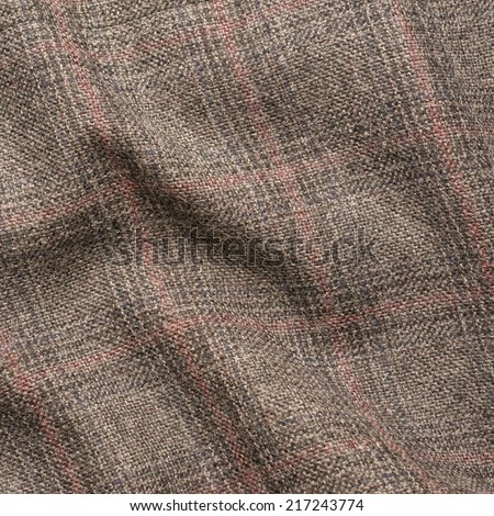 Creased tweed striped jacket cloth material fragment as a background texture composition - stock photo
