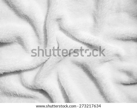 Creased white cloth material fragment as a background texture - stock photo