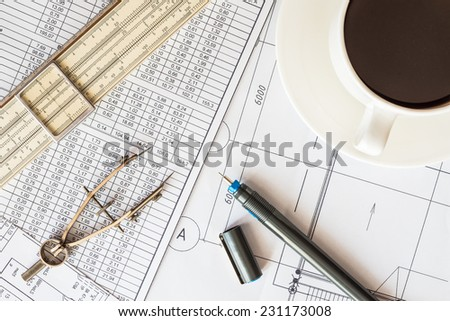 Create a drawing, a pen and instrument for measuring on the table - stock photo