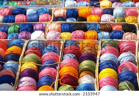 Create anything with colorful threads. Life is color!!! - stock photo
