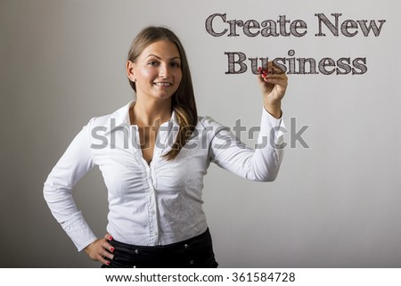 Create New Business - Beautiful girl writing on transparent surface - horizontal image