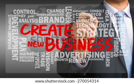 create new business concept with related word cloud handwritten by businessman - stock photo