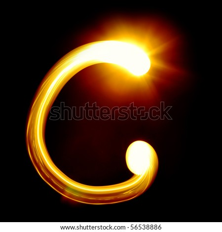 Created by light alphabet over black background - stock photo