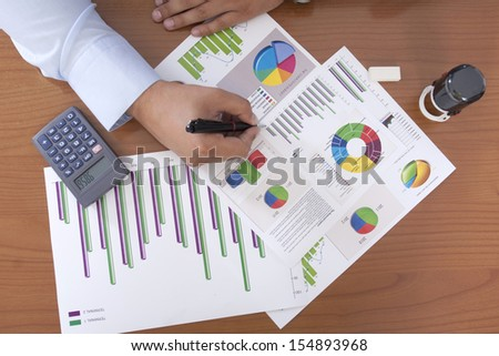 creating a business plan in the office - stock photo
