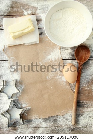 Creating a Recipe Directly above view of blank paper surrounded by basic ingredients. Add own text.  - stock photo