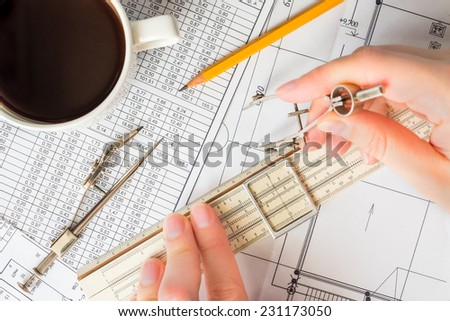 Creating the drawing, the ruler to measure distances and means for drawing - stock photo