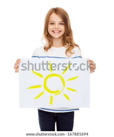 creation, art, family, happiness and painting concept - smiling little child holding picture of sun - stock photo