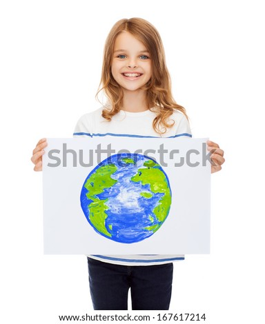 creation, art, planet, happiness and painting concept - smiling little child holding picture of planet - stock photo