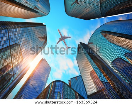 Creative abstract business corporate construction industry and real estate financial concept: blue modern glass reflective skyscrapers in city downtown district with sun light and airliner - stock photo