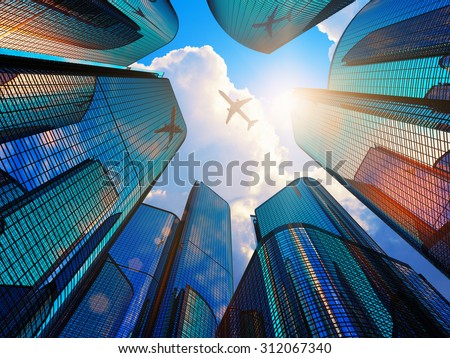 Creative abstract business corporate construction industry and real estate financial concept: blue modern high tall glass reflective skyscrapers in city downtown district with sun light and airliner - stock photo