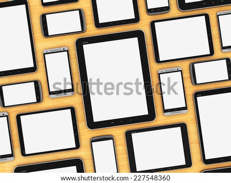 Creative abstract mobility and digital wireless communication technology business concept: group of blank tablet computer PC and empty modern touchscreen smartphones or mobile phones on wooden table - stock photo