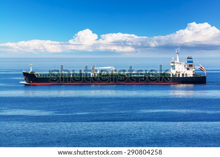 Creative abstract oil and gas industry and sea transportation, shipping and logistics business trading commerce concept: Industrial oil and chemical commercial tanker ship vessel in blue ocean