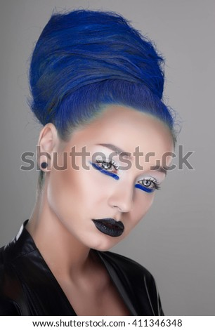 creative and futuristic look of fashion woman with blue hair