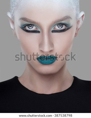 creative and futuristic look of fashion woman with green hairstyle - stock photo