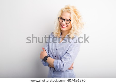 Creative and pretty woman with crossed hands smiling