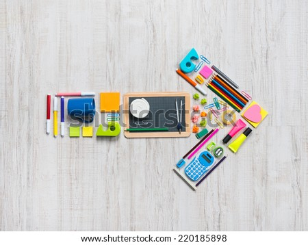 Creative arrow composed of stationery and office objects. - stock photo