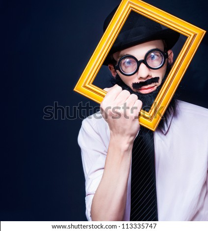 Creative Artistic Man Thinking Outside Of The Rectangular Square While Looking Through A Picture Frame In A Depiction Of A Social Media Profile Picture