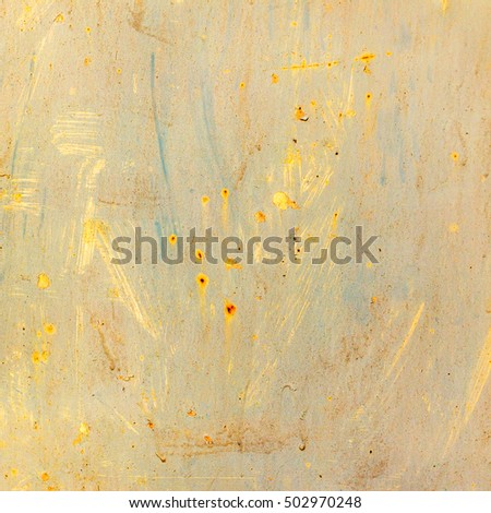 Creative background of rusty metal, painted with yellow paint. Grungy metal surface. Great background or texture for your project.