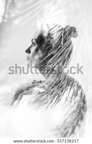 Creative black and white double exposure portrait of attractive girl