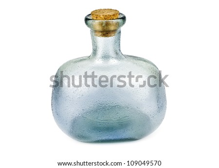 creative bottle made of blue glass isolated on white background. Frontal view - stock photo