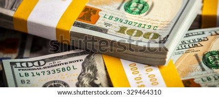 Creative business finance making money concept -  letterbox panoramic background of new 100 US dollars 2013 edition banknotes (bills) bundles close up - stock photo