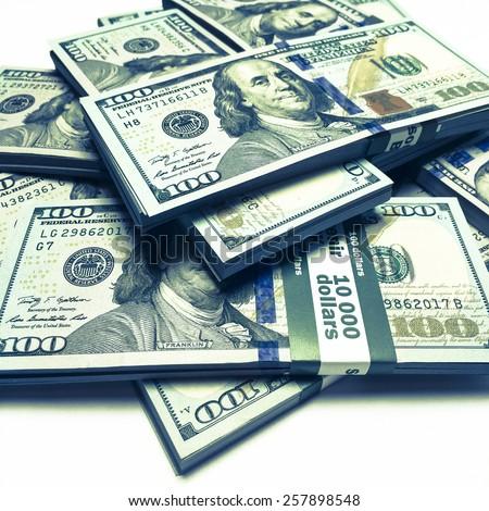 Creative business finance making money concept / Vintage retro effect filtered image of heap of new 100 (hundred) US dollars banknotes (bills) bundles close up - instagram effect - stock photo