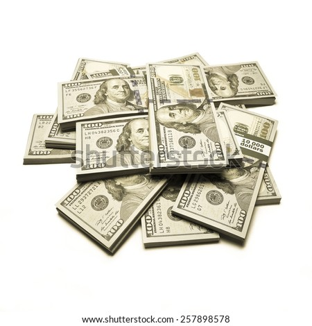 Creative business finance making money concept / Vintage retro effect filtered style image of pile of new 100 (hundred) US dollars banknotes (bills) bundles - instagram effect, isolated - stock photo