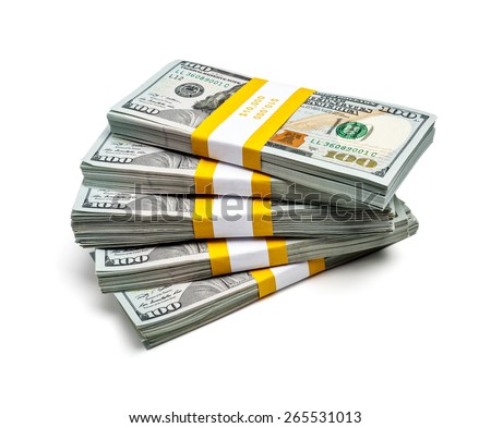 Creative business finance making money wealth success concept - stack of bundles of 100 US dollars 2013 edition banknotes (bills) isolated on white