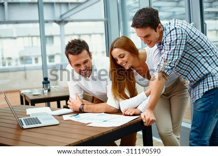 Creative business partners discussing documents at meeting - stock photo