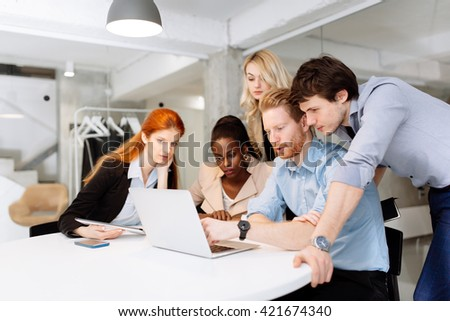 Creative business people and designers  brainstorming in a modern office