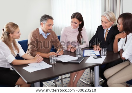 Creative business team having a meeting together in boardroom - stock photo