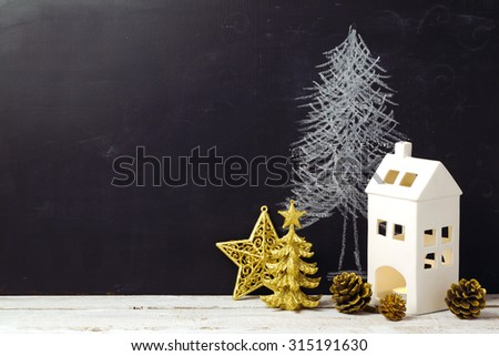 Creative Christmas still life with decorations and chalkboard - stock photo