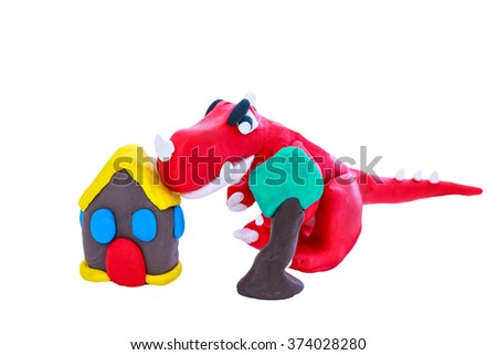 Creative clay model. Red dinosaur, house and tree from children bright plasticine, isolated on white background. Play dough animal. - stock photo