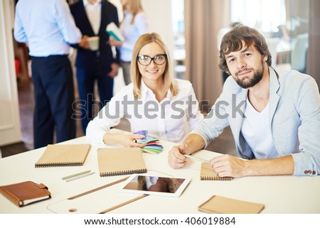Creative colleagues having briefing on design project - stock photo