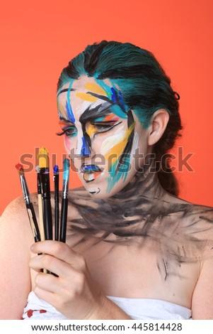 Creative Colorful Beauty Portrait of Intense Make Up Cosmetics - stock photo