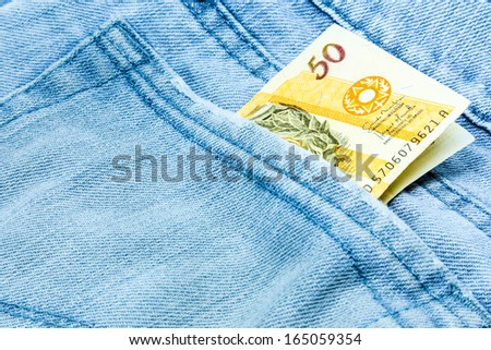 Creative composition of Brazilian Money (Reais) on the jeans - stock photo