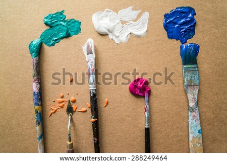 creative composition of brushes in paints - stock photo