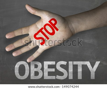Creative composition with the message Stop Obesity - stock photo