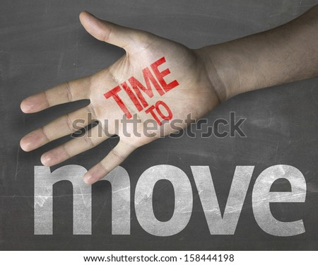 """Creative composition with the message """"Time to Move"""" - stock photo"""