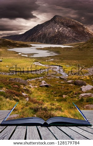 Creative concept image of dramatic sky over mountain range in pages of book - stock photo